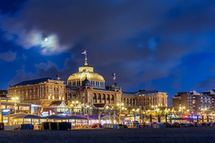 Kurhaus in blue hour (zilverbat.) Tags: dutch longexposure scheveningen zilverbat longexposurenetherlands longexposurewater kurhaus clouds dutchholland image denhaag dramatic moon architecture thenetherlands thehague timelife town travel tripadvisor trip visit wallpaper world lenight nightphotography nightshot nightlights night nightimage vlag flag driekleur heritage erfgoed