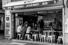 Afternoon bite (Deniz Kilicci) Tags: sony a6500 blackandwhite people family friends cafe melbourne