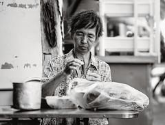 Methodical (toastal) Tags: songkhla songkhlaoldtown thailand bw dailylife mealprep oldwoman portrait silverhair streetfood streetportrait woman wrinkles happyplanet asiafavorites