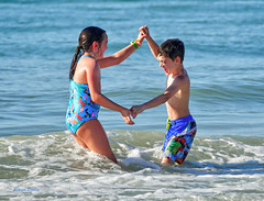 siblings-3 (albyn.davis) Tags: children siblings boy girl water ocean vacation playful playing action light people color colors blue brother sister