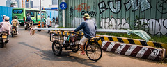 2019 - Vietnam, Saigon - Avalon Waterways Tour - 14 - HCMC Street Scene (Ted's photos - Returns Early February) Tags: 2019 avalonwaterways cropped hochiminhcity nikon nikond750 nikonfx saigon tedmcgrath tedsphotos vietnam vignetting streetscene street shadow shadows graffiti bus hcmc pipe longpipe motorcycles backpack wheels wideangle widescreen
