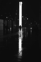 In front of the giant lamp (pascalcolin1) Tags: paris13 homme man nuit night reflets reflection lampe lamp photoderue streetview urbanarte noiretblanc blackandwhite photopascalcolin 50mm canon50mm canon
