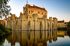 Gravensteen, Ghent's Castle (Brett of Binnshire) Tags: mote historicbuilding canal pond fortress water ghent tower stonebuilt eastflanders architecture locationrecorded wall belgium castle fort gent