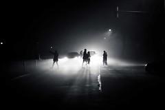 through the light (blende9komma6) Tags: hannover südstadt germany through light licht night nacht bw sw traffic people mensch street dark dunkel nebel fog mist cars autos walk wait urban city ricoh gr griii schatten shadow black white