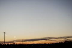 Sky (4 January 2020) (jolynne_martinez) Tags: sky sunset clouds cloudy utilitypole utilitypoles silhouette horizon blue orange black nikkor nikon nikond60 photoshop oilpaintingfilter oilpainting