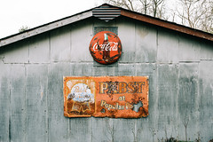 They Arrived Together, But Left Separately (The Really Bad Photographer) Tags: coke beer signs barn metal day cloudy crystalsprings arkansas 2019 usa nikon z7 raw lr rural