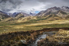 Impressive Andean mountains (marko.erman) Tags: latinamerica southamerica highaltitude abralaraya andes perurail train landscape impressive mountains snowcapped sony travel outside outdoor nopeople nature wilde snow clouds green