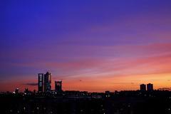 Madrid Skyline (@edu.valero (Instagram)) Tags: skyline madrid madridskyline atardecer sunset puestadesol anochecer azul blue rojo red cuatrotorres cuatro four fourtowers kio torreskio
