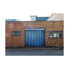 untitled (chrisinplymouth) Tags: door garagedoors blue wall brick window foldingdoors plymouth devon england uk city cw69x trait cameo urbio xg 2017