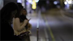 """""""Waiting for a Taxi"""" Sai Ying Pun, Hong Kong, China (December 2019) (Kommie) Tags: sai ying pun hong kong china street candid low light night photography bokeh fujifilm xt3 fujinon 56mm f12 r woman lady girl pro neg hi"""