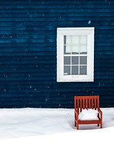 The Red Chair (Karen_Chappell) Tags: red chair snow bench winter january house blue white window architecture newfoundland nfld canada eastcoast avalonpeninsula atlanticcanada stjohns canonef24105mmf4lisusm weather snowy snowing wood wooden paint painted clapboard color colour