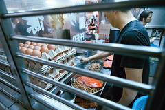 Chinatown Char Kway Teow (Jon Siegel) Tags: nikon d750 20mm voigtlanger voigtlander20mmf35 20mm35 man cooking kitchen charkwayteow noodles chinatown singapore singaporean