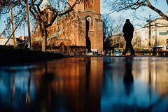 Morning Service (ewitsoe) Tags: 35mm everydaymoments nikon street warszawa winter citylife erikwitsoe poland urban warsaw ice reflection silhouette cathedral man walking water cold puddle frozen morning catholic