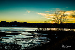 Sunset on Ice (Kent Copeland) Tags: mountains clouds sunset water reflections ice landscape nature boulder colorado