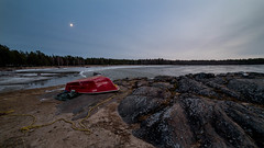 Cold in the moon light (Mika Lehtinen) Tags: sea boat shore beach winter empty cold ice water red sky moonlight rocks stone