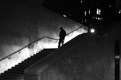 Along the tagged wall (pascalcolin1) Tags: paris13 homme man nuit night lumière light ombre shade escalier stairs marches steps photoderue streetview urbanarte noiretblanc blackandwhite photopascalcolin 50mm canon50mm canon