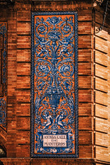 Azulejos (Мaistora) Tags: history historic traditional architecture culture moorish andaluz andalus andalusia andalucia seville sevilla spain espana light shadow leica typ109 dlux lightroom luminar skylum ceramic tile art craft design decoration decorative ornament ornamental glazed enamel enamelled blue azul azulejo handpainted tradition tiling ornamented motif signage sign plate street building identity hawkers smugglers peddlers illegal trade retail market closeup zoomin oldtown oldcity medieval