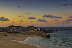 Sunset over St Ives, Cornwall (Steve M Photography) Tags: sunset dusk twilight stives cornwall cornish southwest seascape southcoast sea seaside ocean holidaydestination vacation beacheslandscapes shore sky orangesky lighthouse clouds