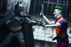 Opposites Attract (Gary Burke.) Tags: joker batman dccomics comics superhero dcuniverse gotham hero gothamcity detective crimefighter darkknight character mezco actionfigure toy toys toyphotography sony a6300 mirrorless sonya6300 one12collective brucewayne capedcrusader mezcoone12collective batmansovereignknight sovereignknight diorama extremesets villain evil supervillain fight brawl showdown asylum longexposure