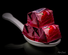 Macro Mondays - Contained (Magda Banach) Tags: chocolates contained nikond850 blackbackground cherriesinchocolate colors macro macromondays porcelainteaspoon red reflection sweets