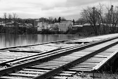 Schaghticoke Tracks (fotofish64) Tags: railroadtracks railroadbridge perspective schaghticoke village hoosicriver winter blackandwhite monochrome pattern outdoor pentax pentaxart kmount k70 hdpentaxda1685mmlens rensselaercounty newyork capitaldistrict river