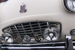 Behold St. Christopher (GmanViz) Tags: gmanviz color sonya6000 car automobile vehicle detail triumph tr3 grille bumper lights badges chrome columbuscarscoffee