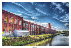 Historic Mills, Lawrence, MA USA (Pearce Levrais Photography) Tags: building architecture arch arches a7r3 sony hdr landscape outdoor outside tourism sky cloud water canal reflection plant window windows big huge historic lawrence ma massachussetts manufacturing ilce7rm3