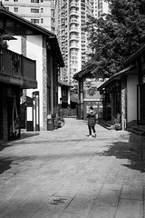 Lost between old and new (Go-tea 郭天) Tags: chongqing républiquepopulairedechine man walk walking alone lonely new old ancient building construction traditional tradition history historical historic alley pavement back backside lost street urban city outside outdoor people candid bw bnw black white blackwhite blackandwhite monochrome naturallight natural light asia asian china chinese canon eos 100d 24mm prime