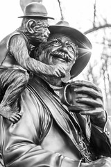 An organ grinder and his beloved monkey (Explored) (sniggie) Tags: knoxville tennessee blackwhitephotography highlandmemorialcemetery cemetery monkey organgrinder showman entertainers bagwellfamily
