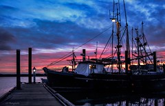 Finale - Steveston Fishing Village (Christie : Colour & Light Collection) Tags: steveston dock pier wharf fishboat fishingvillage piles sunset lowlight richmond bc canada nikon nikkor skylight clouds boat silhouette redsky nautical harbour harbor fraserriver straitofgeorgia breakwater sundown river evening 2020 fishingvessel moored moor docklantern docklight flickr finale trawler