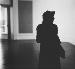 Time and Time Again (Gabriella Ollandini) Tags: silhouette woman lady vintage 1930s 1940s monochrome bw analog analogue 35mm film hat filmisnotdead filmnoir glamour softfocus cinematic noir ricoh shadows filmstar mystery thirties forties
