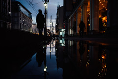 Silver Linings (ewitsoe) Tags: city nikon nikond750 reflection street warszawa winter erikwitsoe urban warsaw woman silhouette puddle night evening dusk tram cinematic water pool walking stride urbanscene