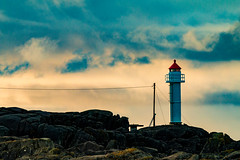 Did Anyone Plug in the Light? (langdon10) Tags: karmøy northsea norway clouds coast lighthouse powerlines rock shoreline