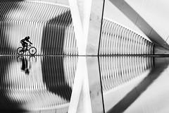 Biker (Leipzig_trifft_Wien) Tags: street streetphoto bnw blackandwhite valencia human symmetrical reflection pattern structure form urban
