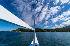 Puerto Galera-165 (walterkolkma) Tags: philippines mindoro island beach corals puertogalera whitebeach aninuan tamaraw banca outrigger boat ship sunny skies palm kolkma sony a7iii