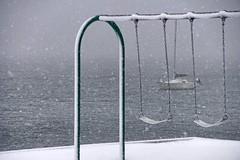 Swings (juanita nicholson) Tags: swings swing snow ice harbour harbor boat sailboat icy gray grey water ocean sea winter
