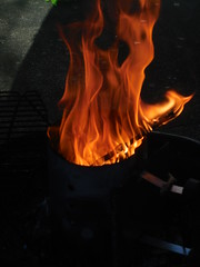 DSCN0224 (tombrewster6154) Tags: flames bright colors outside nature outdoor photography digital camera picture hot heat midspring 2019 mmxix tuesday cooking grill dinner natural beauty tower metal silver sticks wood handle late april
