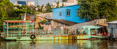 2019 - Vietnam-Avalon Siem Reap - 15 - River Cruise - Mekong River Ferry (Ted's photos - Returns Early February) Tags: 2019 avalonwaterways cropped mekongriver nikon nikond750 nikonfx tedmcgrath tedsphotos vietnam vignetting ferry river rivercrossing motorcycles railing reflection waterreflection rusty rustyboat boat vessel wideangle widescreen