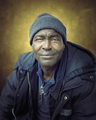 Allen (mckenziemedia) Tags: man portrait portraiture face smile stockingcap chicago city urban street streetphotography people humanity homeless homelessness coat