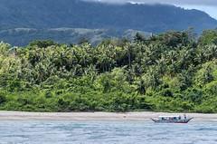 Puerto Galera-85 (walterkolkma) Tags: philippines mindoro island beach corals puertogalera whitebeach aninuan tamaraw banca outrigger boat ship sunny skies palm kolkma sony a7iii