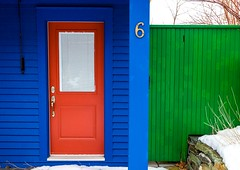 Primary Colours (Karen_Chappell) Tags: rgb red green blue house home door architecture colours colors colourful color thebattery stjohns snow winter newfoundland nfld canada eastcoast canonef24105mmf4lisusm atlanticcanada avalonpeninsula fence window number bright wood wooden paint painted clapboard white 6 lines geometric