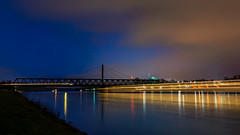 Blue hour Rhine traffic (mike | MKvip.photo) Tags: sony⍺7rii sonyalpha sigmafe24mmf14dghsmart availablelight naturallight night nightlights sunset sunsetlight bluehour water river rhine rhein reflection reflections industrial longexposure nature sky clouds stars sunstars winter rhinebridge ship excursionship karlsruhe kvv tram wörthamrhein maximiliansau pfalz rheinlandpfamz rhinelandpalatinate germany europe mth mkvip gggggggg g