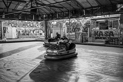 A dodgem car ride (Braca Stefanovic) Tags: authentic amusement bw boy bump car casual child city enjoyment europe family fair fun funfair kid life mom mother ordinary streetphotography real ride scene woman winter urban bracastefanovic belgrade serbia