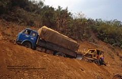 near Muang Xai, local traffic problems (blauepics) Tags: southeast asia südostasien laos lao nambak muang xai city stadt mountains berge landscape landschaft traffic verkehr new road neue strase infrastructure infrastruktur vehicle trafficjam stau problem truck lkw