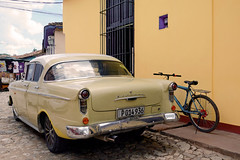 Kapitän (emerge13) Tags: opelkapitän classiccars germancars vintagecars cuba trinidadsanctispirituscuba trinidadcuba streets colorfulcities colorfulstreets cobblestonestreets yellow cobblestone