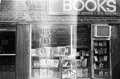 BOOKS (Gabriella Ollandini) Tags: bw monochrome 35mm lightleaks books bookstore filmisnotdead nyc retro nostalgia vintage filmphotography analogue analog storefront shop signage oldfashioned grain ilford softfocus zenit helios 50mm filmnegative shopfront sign manhattan