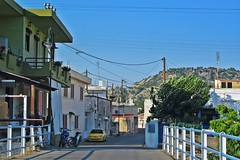 Greek village :) (green_lover (your COMMENTS are welcome!)) Tags: road malonas rhodes greece village houses bridge fence balcony cloudless vanishingpoint