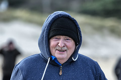 A warm smile on a cold day (Frank Fullard) Tags: frankfullard fullard candid street portrait warm smile cold blue beach strand shore sea atlantic ocean water swim lifeboat tasch moustache hoodie achill dugort doogort mayo irish ireland festive color colour