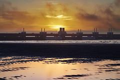 Sunrise over Oosterscheldekering (Photodoos) Tags: canonnl zeeland schouwenduiveland sunrise netherlands water northsea deltaworks canoneos