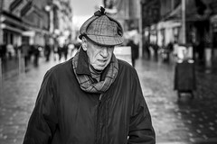 Elementary (Leanne Boulton) Tags: urban street candid portrait portraiture streetphotography candidstreetphotography candidportrait streetportrait streetlife old elderly man male face eyes expression mood feeling emotion deerstalker hat style fashion tone texture detail depthoffield bokeh naturallight outdoor light shade city scene human life living humanity society culture lifestyle people canon canon5dmkiii 70mm ef2470mmf28liiusm black white blackwhite bw mono blackandwhite monochrome glasgow scotland uk